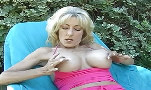 humungous tatas blond in solo action outside