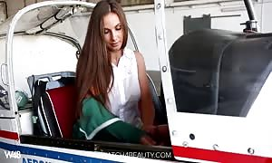 large hooters babe tugging it on a airplane
