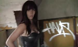 spandex suit looks hot on this dark-haired street walker with gigantic breasts and strap-on dildo vibrator